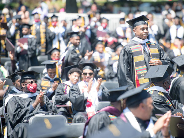 Students applaud at the Morehouse College commencement ceremony on May 16, 2021, in Atlanta. Morehouse recently announced it would clear remaining tuition balances for students, joining several other HBCUs doing the same.
