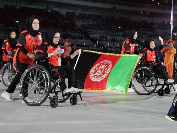 The Afghanistan Paralympic team won't compete in the Tokyo Paralympics, with commercial air travel halted due to the Taliban's sudden takeover. Here, the country's athletes are seen at the opening ceremony of the 2018 Asian Para Games at the Gelora Bung Karno main stadium in Jakarta.
