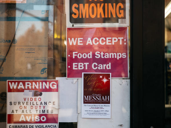 A sign alerts customers about SNAP food stamp benefits at a grocery store in New York City in December 2019. Benefits from the Supplemental Nutrition Assistance Program are getting a historic boost nearly two years later under the Biden administration.