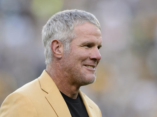 Former NFL quarterback Brett Favre looks on as he is inducted into the Ring of Honor during a halftime ceremony during the game between the Green Bay Packers and the Dallas Cowboys on Oct. 16, 2016.