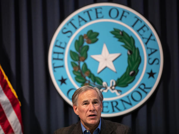 Texas Gov. Greg Abbott, pictured here in July, is not experiencing any symptoms, his office said Tuesday.