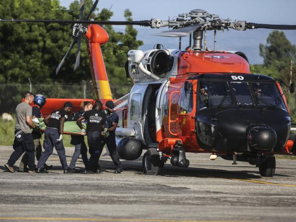 A person injured in the earthquake is transferred to a US Coast Guard helicopter in Les Cayes, Haiti, Monday, Aug. 16, 2021, two days after a 7.2-magnitude earthquake struck the southwestern part of the country.
