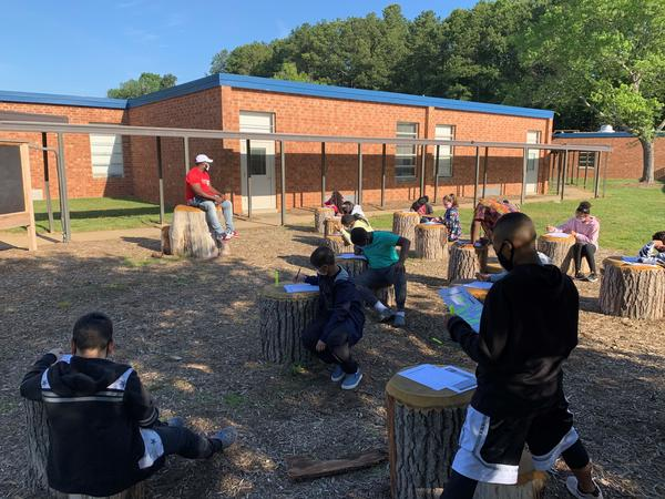 Students at Foust Elementary School in Greensboro, North Carolina gather in an outdoor classroom.