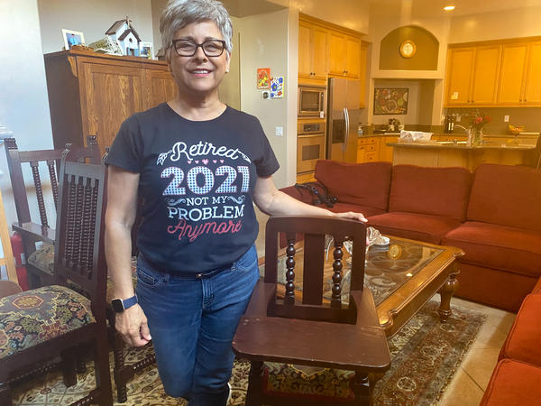 Norma Jasso, 62, sped up retirement plans after her daughter asked for help with a new baby. She stands with a high chair her father had commissioned from a shop in Sinaloa, Mexico. Her daughters used it and now her grandson will too.