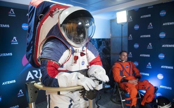 The two NASA spacesuit prototypes, one for exploring the surface of the moon's South Pole (left) and one for launch and reentry aboard the agency's Orion spacecraft, won't become a reality in time for a planned 2024 mission.