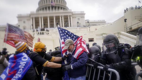 Rioters try to break through a police barrier at the U.S. Capitol on Jan. 6.
