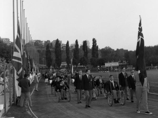 The Australian team parades around the Acqua Acetosa Ground in Rome on Sept. 18, 1960, during the opening ceremony for the Paralympic Games.
