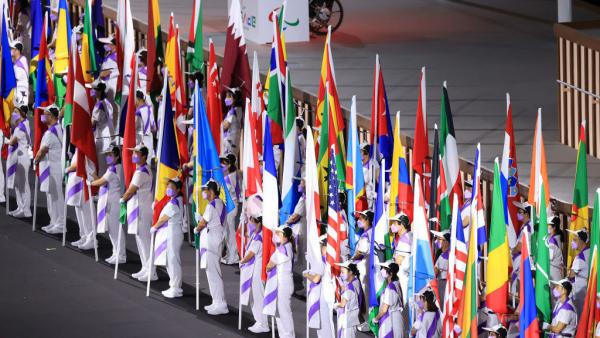 The flags of the participating nations are displayed in the parade of athletes during the opening ceremony of the Tokyo 2020 Paralympic Games on Tuesday.