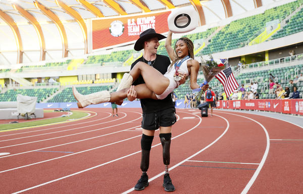 Tara Davis celebrates with boyfriend and Paralympian Hunter Woodhall at the 2020 U.S. Olympic Track & Field Team Trials on June 26 in Eugene, Ore.