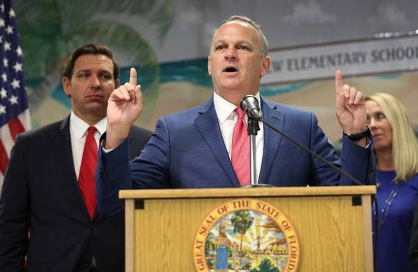 Florida Education Commissioner Richard Corcoran speaks during an October press conference at Bayview Elementary School in Fort Lauderdale where he and Gov. Ron DeSantis, left, announced a plan to raise the minimum starting salary for teachers.
