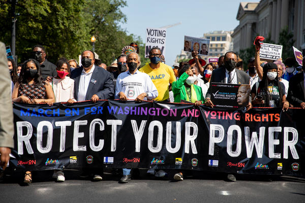 Thousands came to Washington for the March On For Voting Rights. Martin Luther King III, the Rev. Al Sharpton, and Texas Rep. Sheila Jackson Lee are among those pictured.
