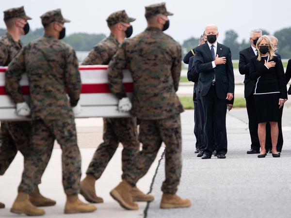 President Biden attends the dignified transfer of the remains of a fallen service member at Dover Air Force Base in Dover, Del., on Sunday.