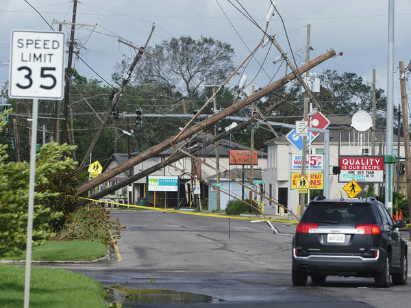 Hurricane Ida leaves downed power lines in its wake Monday in Metairie, La. The one-two punch of a natural disaster and the pandemic is complicating efforts to evacuate hospitals, seek shelter and administer COVID-19 vaccines.