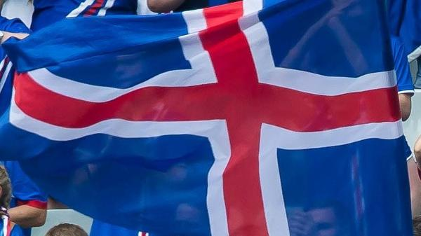 Iceland's soccer federation is in turmoil, after a scandal over sexual assault allegations against players prompted a mass resignation. Here, the country's flag is seen in the stands during an international match.