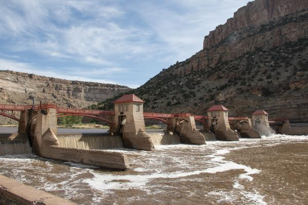 """The Grand River Diversion Dam, also known as the """"Roller Dam"""", was built in     1913 to divert water from the Colorado River to the Government Highline     Canal, which farmers use to irrigate their lands in the Grand Valley."""