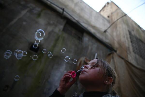 <strong>Jan. 19, 2017:</strong> <em>Douma</em> — A young girl blows bubbles.