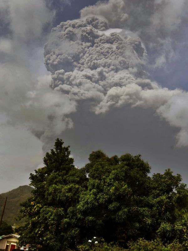 Plumes of ash rise on Friday from the La Soufrière volcano as it erupts on the eastern Caribbean island of St. Vincent, as seen from Chateaubelair.