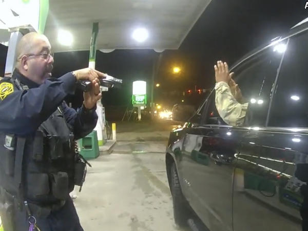 Officer Joe Gutierrez aims his weapon at Lt. Caron Nazario during a traffic stop. Nazario is suing Gutierrez and the other officer, Daniel Crocker, for violation of his constitutional rights.
