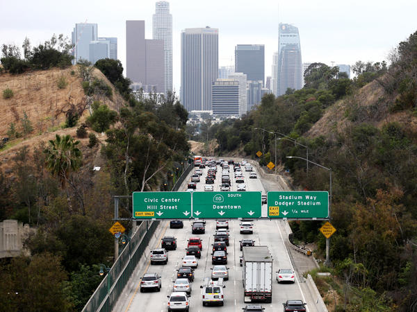 Cars make their way toward downtown Los Angeles on Thursday. California could regain the right to set its own vehicle emissions standards after the Environmental Protection Agency announced it was moving to curb a Trump-era policy that sought to erode the state's previously held power.