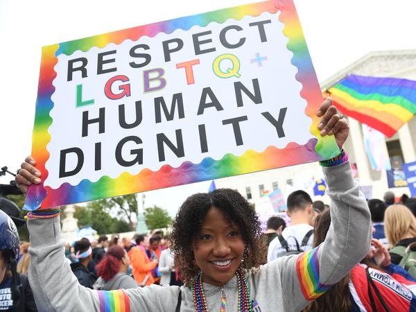 A new report by GLAAD highlights the high rate of harassment and hate facing LGBTQ users on social media. In this photo, demonstrators rally in favor of LGBTQ rights outside the U.S. Supreme Court in 2019.
