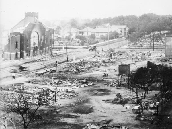 Buildings were destroyed in a massive fire during the Tulsa Race Massacre when a white mob attacked the Greenwood neighborhood, a prosperous Black community in Tulsa, Okla., in 1921. Eyewitnesses recalled the specter of men carrying torches through the streets to set fire to homes and businesses.
