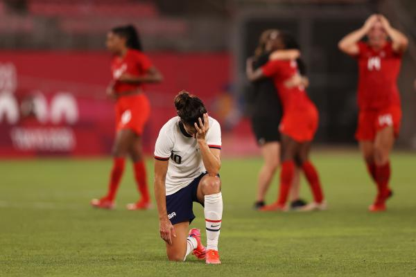 Carli Lloyd of the U.S. women's soccer team looks dejected after Monday's defeat in the semifinal match against Canada at the Tokyo Olympics.