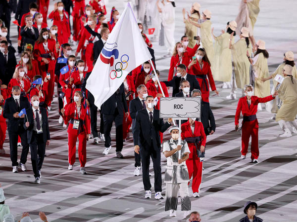 The team from the Russian Olympic Committee enters the Olympic Stadium during the opening ceremony of the Tokyo Olympics. They were prevented from flying the Russian flag because of ongoing doping penalties.