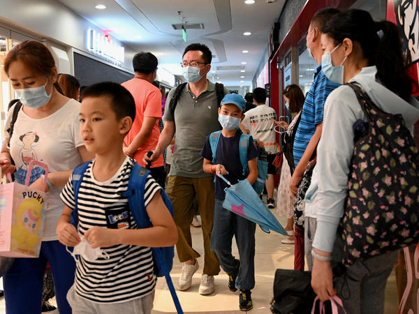 Students and parents walk after a private after-school session in Beijing's Haidian district, where competition is cutthroat for a spot in top schools.