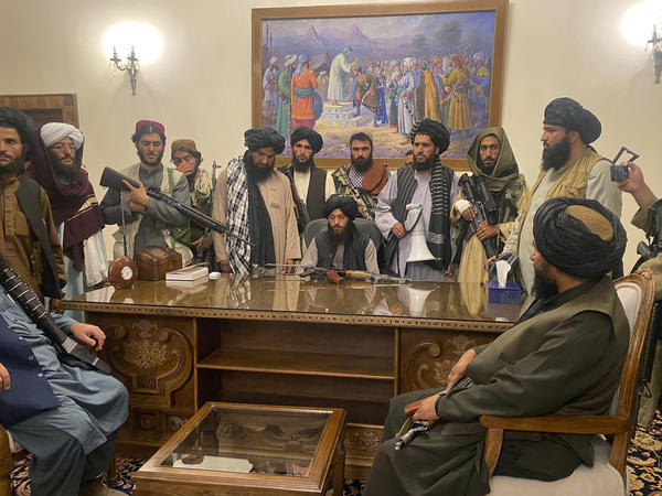 Taliban fighters take control of the Afghan presidential palace in Kabul on Sunday after Afghan President Ashraf Ghani fled the country.