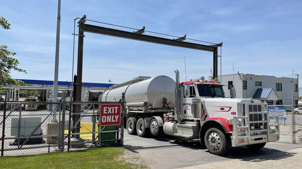 A driver exits the yard after filling up his gas tanker truck at Marathon Oil on May 20 in Salt Lake City.
