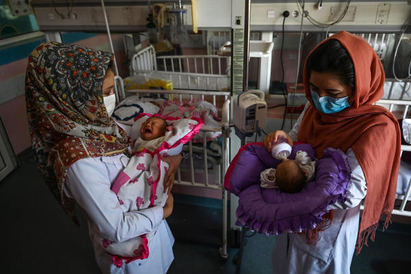 Nurses feed newborn babies rescued and brought to Ataturk National Children's Hospital in Kabul, Afghanistan, on May 15, 2020, after their mothers were killed in an attack on a maternity ward operated by Doctors Without Borders. The health-care nonprofit runs clinics and hospitals in various parts of the country.