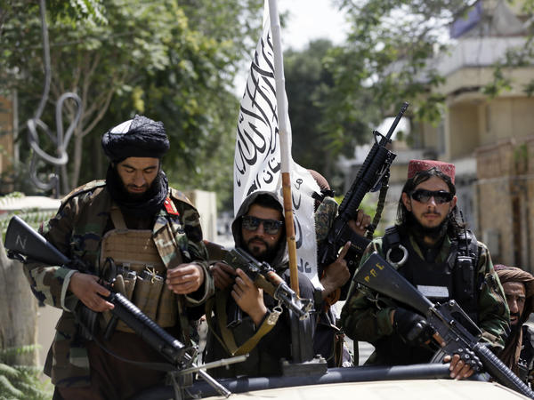 Taliban fighters patrol through Kabul, Afghanistan, on Thursday. Pictures of such fighters posing with captured aircraft, weapons and vehicles have been showing upon social media.