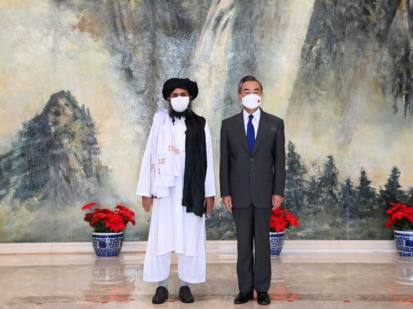 Chinese Foreign Minister Wang Yi meets with Afghan Taliban leader Abdul Ghani Baradar in Tianjin, China, on July 28.