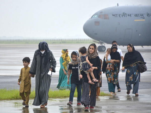 People evacuated from Kabul arrive at Hindon Air Force base near New Delhi, on Sunday. Despite entreaties from the Taliban, India choose to evacuate its diplomats earlier this month.