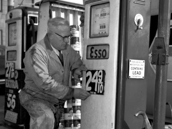 In December 1955, a man posts a price for leaded gasoline at a station in Everett, Massachusetts. The United Nations said on Monday that the world is no longer using the toxic fuel, bringing an end to a century of damaging pollution.