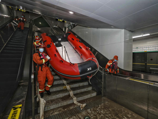 Rescuers carried a boat into the subway in Zhengzhou, China in July after flash floods trapped passengers underground.