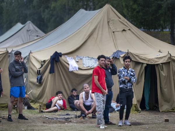 Migrants rest at the newly built refugee camp near Rudninkai, Lithuania, earlier this month. Lithuania has faced a surge of mostly Iraqi asylum seekers crossing the border illegally from Belarus with the assistance of the government in Minsk.