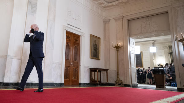 President Biden walks from the podium in the White House on Tuesday after speaking about the end of the war in Afghanistan.