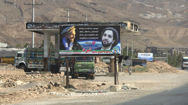 """A banner in the Panjshir Valley portrays of Ahmad Massoud and his father with a slogan """"You dream of a free country, free thanks to your army, Ahmad is by your side, may God protect you."""""""