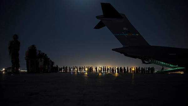 A U.S. Air Force air crew prepares to load evacuees aboard a C-17 aircraft at Hamid Karzai International Airport in Kabul, Afghanistan, on Aug. 31. Several public school students from Sacramento, Calif., remain in Afghanistan since the U.S. evacuation ended.