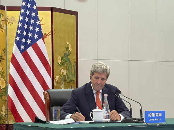 In this photo provided by the U.S. Department of State, U.S. Special Presidential Envoy for Climate John Kerry attends a meeting with Chinese Foreign Minister Wang Yi via video link in Tianjin, China, Wednesday, Sept. 1, 2021. Wang warned Kerry on Wednesday that deteriorating U.S.-China relations could undermine cooperation between the two on climate change.