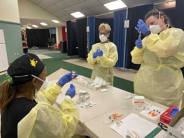 Health workers prepare injections of Regeneron at the monoclonal antibody treatment site in Tampa. Patients receive four shots of the antibody cocktail.