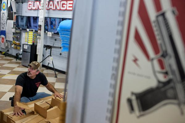 Employee Curt Hubbard unloads a shipment of ammunition at Full Armor Firearms in Houston in June.