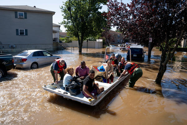 Members of the fire department in Lodi, N.J., perform water rescues Thursday on residents trapped after torrential rains from the remnants of Hurricane Ida.