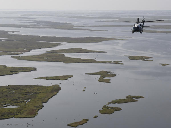 President Biden, aboard Marine One, inspects the damage from Hurricane Ida on an aerial tour of communities in Laffite, Grand Isle, Port Fourchon and Lafourche Parish, Louisiana, on Sept. 3, 2021. Port Fourchon is a major oil and gas hub in the Gulf region.