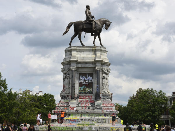 Protesters climb on the base of the statue of Confederate General Robert E. Lee on Monument Avenue on June 6, 2020 in Richmond, Virginia amid continued protests over the death of George Floyd in police custody. The statue is set to be taken down on Sept. 8, 2021.