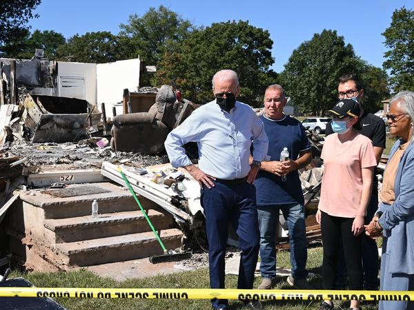 President Biden tours a Manville, N.J., neighborhood Tuesday that was affected by the remnants of Hurricane Ida.
