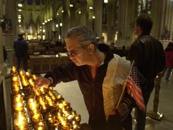 A man in New York City lights a candle on Sept. 14, 2001, for the victims of the Sept. 11 terrorist attacks.