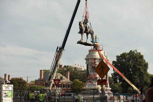The statue of Confederate Gen. Robert E. Lee is removed from its pedestal in Richmond, Va., on Sept. 8, 2021.