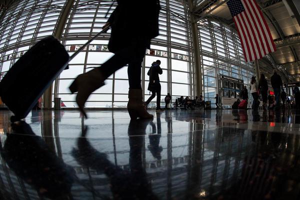 A traveler at Ronald Reagan Washington National Airport walks to a Transportation Security Administration checkpoint on Nov. 26, 2014.